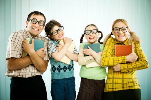 143919053-nerd-family-holding-their-books-and-looking-gettyimages