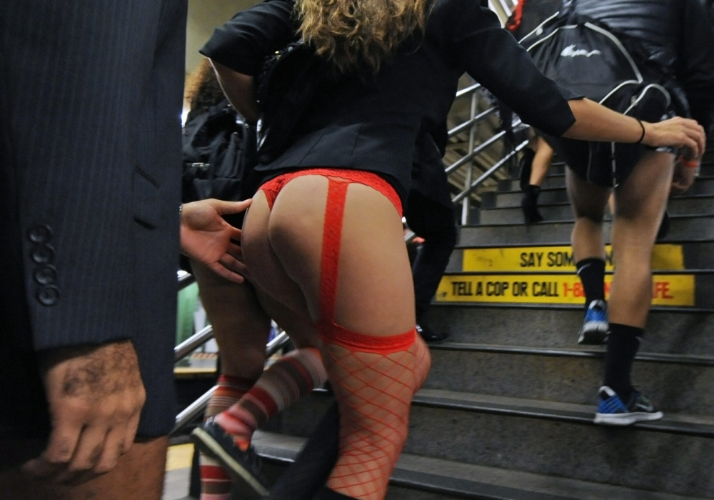 epa03534313 People participate in the 12 Annual 'No Pants Subway Ride 2013' in New York, USA, 13 January 2013. The organizers, Improv Everywhere is a New York City-based prank collective that causes scenes of chaos and joy in public places. EPA/PETER FOLEY