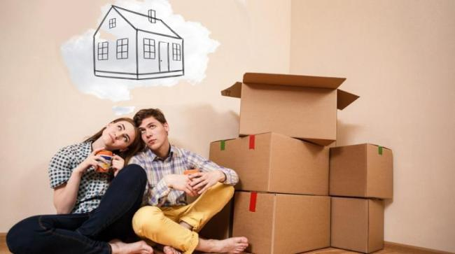 180831011553_young-couple-first-time-home-buyers-dreaming-with-boxes.jpg