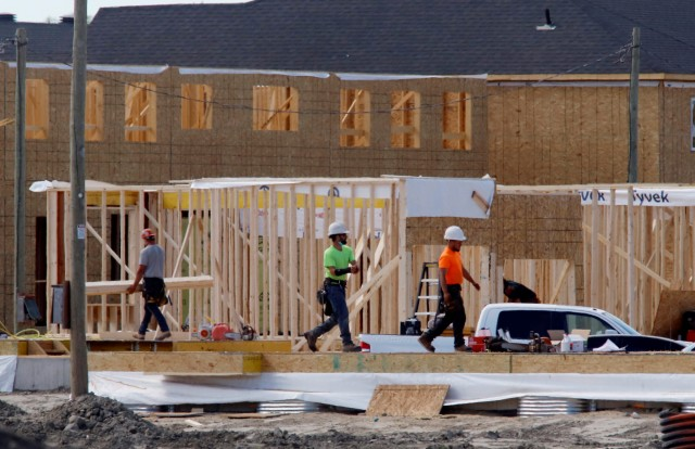 Construction workers work on new homes in Ottawa, Ontario, Canada, May 27, 2021. REUTERS/Patrick Doyle
